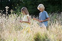 preteen girl - Children walking in an overgrown field Stock Photo - Premium Royalty-Freenull, Code: 6114-06663668