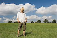 preteen long hair - Boy standing in a field Stock Photo - Premium Royalty-Freenull, Code: 6114-06663670