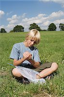 preteen long hair - Boy holding a butterfly Stock Photo - Premium Royalty-Freenull, Code: 6114-06663682