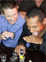 Men drinking shots at a bar Stock Photo - Premium Royalty-Freenull, Code: 6114-06664212