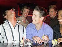 Men drinking shots at a bar Stock Photo - Premium Royalty-Freenull, Code: 6114-06664217