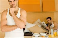 Homosexual couple with breakfast in bed Stock Photo - Premium Royalty-Freenull, Code: 6114-06664295