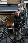 Portrait of mid adult man standing outside cycle shop Stock Photo - Premium Royalty-Free, Artist: Blend Images, Code: 693-06667800