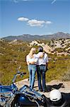 Senior couple look out to desert mountains Stock Photo - Premium Royalty-Free, Artist: Robert Harding Images, Code: 693-06667822