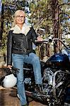 Senior woman in leather jacket poses with motorcycle Stock Photo - Premium Royalty-Free, Artist: Ikon Images, Code: 693-06667829