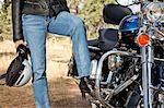 Womans leg rests on motorcycle foot rest Stock Photo - Premium Royalty-Free, Artist: Blend Images, Code: 693-06667831