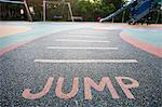 Jump written into rubber floor of playground Stock Photo - Premium Royalty-Free, Artist: Norbert Schäfer, Code: 693-06667849