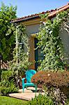 A lonely blue chair outside a house surrounded by plants Stock Photo - Premium Royalty-Free, Artist: Aflo Relax, Code: 693-06667867