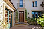 Entrance to a beautiful Mediterranean home exterior Stock Photo - Premium Royalty-Free, Artist: Water Rights, Code: 693-06667869