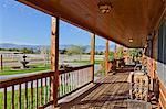 Ranch porch overlooking horse stables Stock Photo - Premium Royalty-Free, Artist: ableimages, Code: 693-06667891
