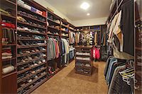 Walk in closet with organized clothing Stock Photo - Premium Royalty-Freenull, Code: 693-06667907