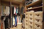 Walk in closet with organized clothing Stock Photo - Premium Royalty-Free, Artist: Mark Burstyn, Code: 693-06667915