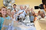Senior man celebrating start of retirement with family and friends Stock Photo - Premium Royalty-Free, Artist: Cultura RM, Code: 693-06667985