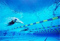 swimming pool water - Four female professional participants racing in pool Stock Photo - Premium Royalty-Freenull, Code: 693-06668089
