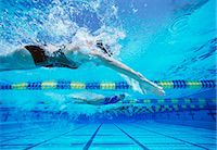 swimming pool water - Four female swimmers racing together in swimming pool Stock Photo - Premium Royalty-Freenull, Code: 693-06668093