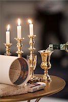 Jewish Wedding Ceremony Items on Table Including Three Lit Candles, and Wine Being Poured into Gold Kiddish Cup Goblet Stock Photo - Premium Rights-Managednull, Code: 700-06669616