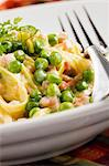 Pasta with Sliced Ham and Peas in a Garlic Butter Sauce; Close Up Stock Photo - Premium Royalty-Free, Artist: Photocuisine, Code: 659-06670872