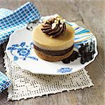 Individual Peanut Butter Chocolate Cheesecake on a Plate Stock Photo - Premium Royalty-Freenull, Code: 659-06670913