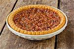 Whole Pecan Pie on a Rustic Wooden Table Stock Photo - Premium Royalty-Free, Artist: Mitch Tobias, Code: 659-06670982