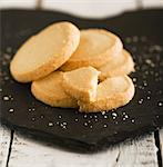 Shortbread biscuits on a slate surface Stock Photo - Premium Royalty-Freenull, Code: 659-06671000