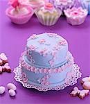 A two tier Easter cake decorated with blue icing and pink sugar flowers Stock Photo - Premium Royalty-Free, Artist: AWL Images, Code: 659-06671064