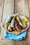 Fried herring with salt and lemon Stock Photo - Premium Royalty-Free, Artist: Blend Images, Code: 659-06671077