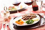 Fillet of beef with salad Stock Photo - Premium Royalty-Freenull, Code: 659-06671161