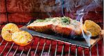 Salmon Topped with Lemon and Dill on an Applewood Plank; On the Grill Stock Photo - Premium Royalty-Free, Artist: Blend Images, Code: 659-06671175