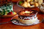 Bowl of French Onion Soup on a Glass Plate Stock Photo - Premium Royalty-Free, Artist: Blend Images, Code: 659-06671191