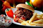 Chopped Barbecue Beef Sandwich on a Bun with French Fries Stock Photo - Premium Royalty-Freenull, Code: 659-06671193