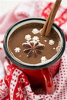 spicy - A cup of hot chocolate with star anise, a cinnamon stick and snow flakes Stock Photo - Premium Royalty-Freenull, Code: 659-06671259