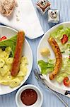 Bratwurst with potato salad and vegetarian sausage with salad Stock Photo - Premium Royalty-Free, Artist: CulturaRM, Code: 659-06671376