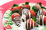 Strawberries coated with white and dark chocolate Stock Photo - Premium Royalty-Free, Artist: Jean-Christophe Riou, Code: 659-06671383