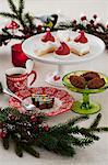 An assortment of baked Christmas goods and a cup of coffee Stock Photo - Premium Royalty-Freenull, Code: 659-06671432