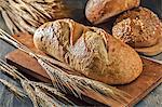 Assorted Loaves of Bread with Wheat Stalks Stock Photo - Premium Royalty-Free, Artist: ableimages, Code: 659-06671549