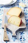 Dutch cheeses (Leerdammer, Old Amsterdam) on a board on a Dutch tablecloth Stock Photo - Premium Royalty-Freenull, Code: 659-06671552