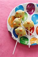 popping (bursting not corks or pimples) - Cake pops (chicks) on a colourful paper plate Stock Photo - Premium Royalty-Freenull, Code: 659-06671579