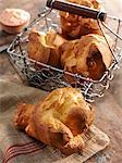 Popover on a Dish Cloth with Popovers in a Wire Basket Stock Photo - Premium Royalty-Freenull, Code: 659-06671615