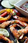 Grilled Shrimp with Limes on a Baking Pan; Dipping Sauce Stock Photo - Premium Royalty-Freenull, Code: 659-06671661
