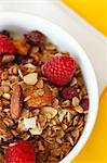 Bowl of Granola with Dried Fruit, Almonds and Raspberries; From Above Stock Photo - Premium Royalty-Freenull, Code: 659-06671668