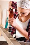 Studio Shot of Young Woman Drilling Lumber Stock Photo - Premium Royalty-Free, Artist: Uwe Umsttter, Code: 600-06671748