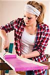 Studio Shot of Young Woman Painting Lumber Stock Photo - Premium Royalty-Free, Artist: Uwe Umstätter, Code: 600-06671758