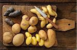 Overhead View of Varieties of Potatoes on Cutting Board with Knife Stock Photo - Premium Royalty-Free, Artist: Jean-Christophe Riou, Code: 600-06671827