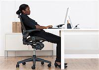 Incorrect seated posture. Stock Photo - Premium Royalty-Freenull, Code: 679-06673769