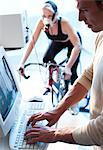 Performance testing. Athlete riding an exercise bike while her performance and oxygen consumption are measured. Stock Photo - Premium Royalty-Free, Artist: Apolonia, Code: 679-06673833