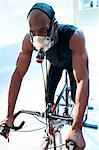 Performance testing. Athlete riding an exercise bike while his performance and oxygen consumption are measured. Stock Photo - Premium Royalty-Free, Artist: Apolonia, Code: 679-06673837