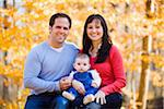 Portrait of Couple Sitting and Holding their Four Month Old Daughter, at Scanlon Creek Conservation Area, near Bradford, Ontario, Canada Stock Photo - Premium Rights-Managed, Artist: Jim Craigmyle, Code: 700-06674979