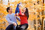 Couple Playing with their Four Month Old Daughter, at Scanlon Creek Conservation Area, near Bradford, Ontario, Canada Stock Photo - Premium Rights-Managed, Artist: Jim Craigmyle, Code: 700-06674980