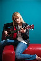 Woman Playing Acoustic Guitar Stock Photo - Premium Royalty-Freenull, Code: 600-06675151