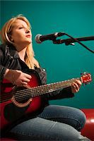 Woman Playing Acoustic Guitar and Singing Stock Photo - Premium Royalty-Freenull, Code: 600-06675157